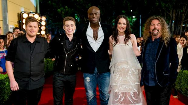 Canberra's Alex Gibson (far left) with his coach on The Voice, Seal.
