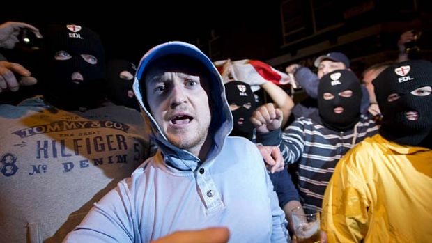 The leader of the English Defence League leader, Tommy Robinson, left, with supporters in Woolwich after the attack