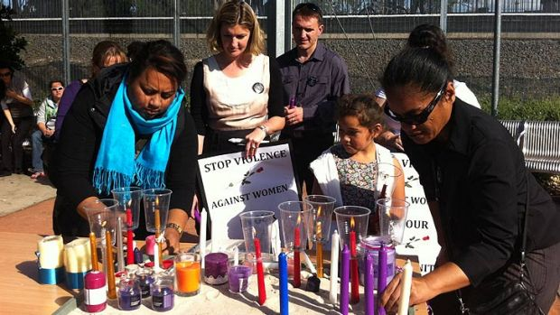 Mourners gather in Logan at a service for slain Joan Canino Ryther.