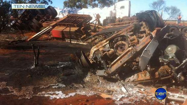 The triple road train after it collided with a utility, killing two men.