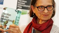 US author Lydia Davis poses after winning the Man Booker Prize