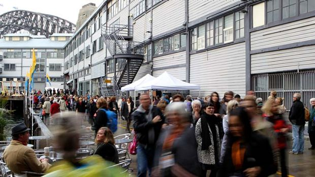 The rain did nothing to deter people from queueing at the Sydney Writers' Festival in Walsh Bay on Thursday.