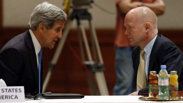 United: US Secretary of State John Kerry talks to British Foreign Secretary William Hague in Jordan.