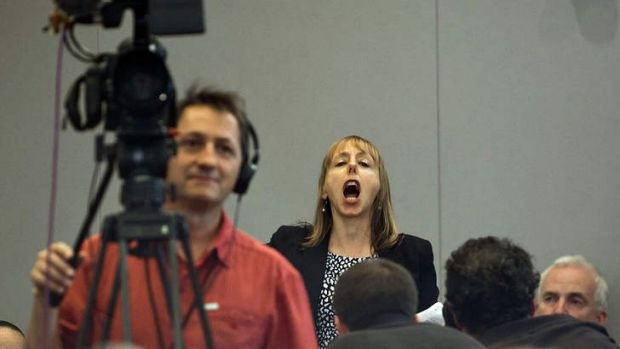 Medea Benjamin, a protester and co-founder of Code Pink, shouts as US President Barack Obama speaks about his ...