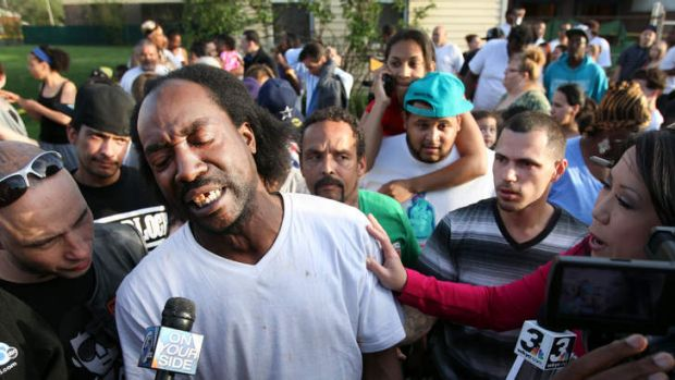 Free burgers: Charles Ramsey speaking to media near the home where missing women Amanda Berry, Gina DeJesus and Michele ...
