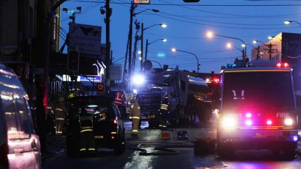 A man died when his tanker crashed into a shop.