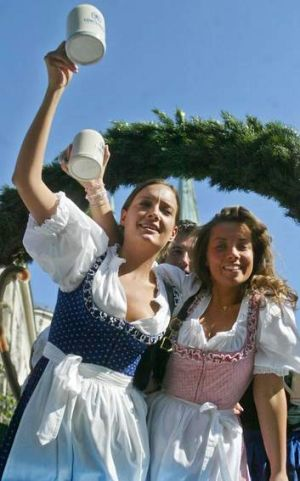 """Two women wearing """"dirndls"""" the Bavarian traditional clothes, during the opening parade of Munich's famed Oktoberfest ..."""