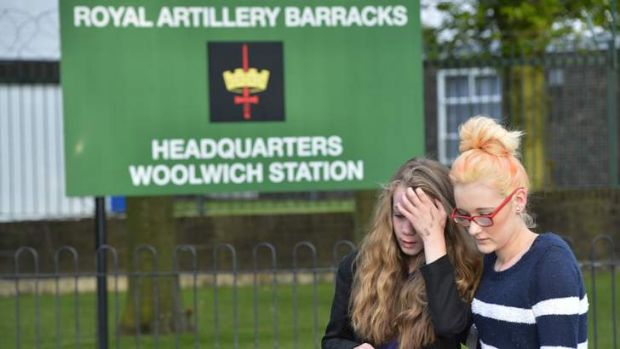Mouners outside an army barracks near the scene of the killing of a British soldier.