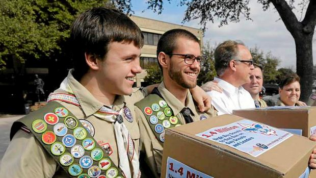 James Oliver, left, hugs his brother and fellow Eagle Scout, Will Oliver, who is gay.