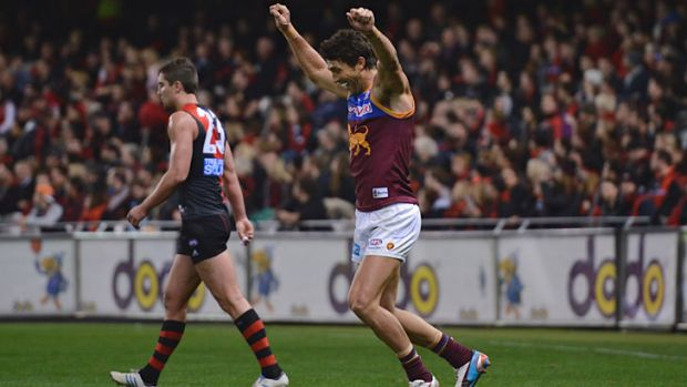 Brent Staker kicks the winning goal for Brisbane late in the last quarter against Essendon at Etihad Stadium.