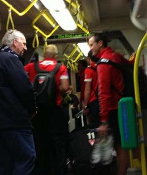 Sydney players take to Melbourne's trams to get to the MCG.