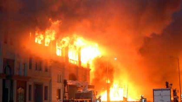Flames engulf a set at the Universal lot.