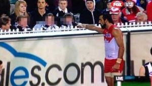 Calling out racism: Adam Goodes points to the offending teen.