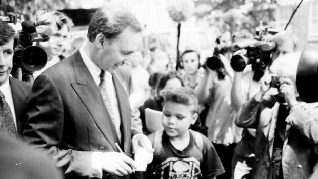 Former Australian Prime Minister, Paul Keating, signs an autograph after delivering an emotional speech in Redfern, ...