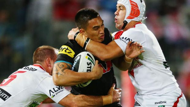 Going nowhere: Dean Whare of the Panthers is tackled by Jason Nightingale and Jamie Soward of the Dragons.