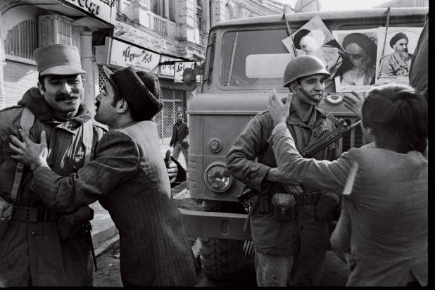 Soldiers join the anti-Shah protestors during the Tehran University demonstration. January 13, 1979.