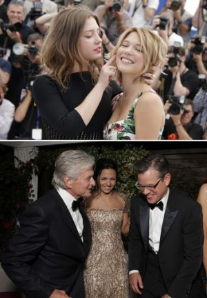 Off-screen performances: Lea Seydoux and Adele Exarchopoulos (above) put on a show at Cannes and (below) Michael Douglas ...