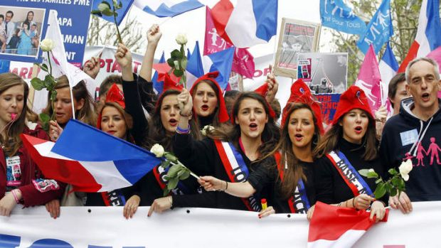 Anti-gay marriage demonstrators waving flags and chanting slogans protest in Paris.