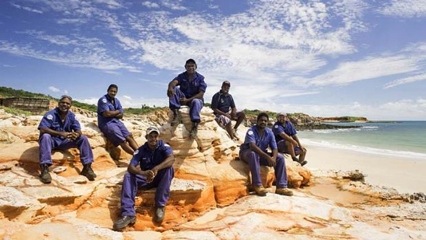 Looking after the land: A group of indigenous rangers take a break. About 680 rangers are employed on more than 50 ...