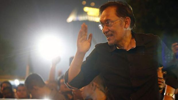 Fired up: Opposition Leader Anwar Ibrahim leaves the rally outside Kuala Lumpur on Saturday.