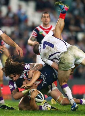 Downed: Cooper Cronk upends Roger Tuivasa-Sheck.
