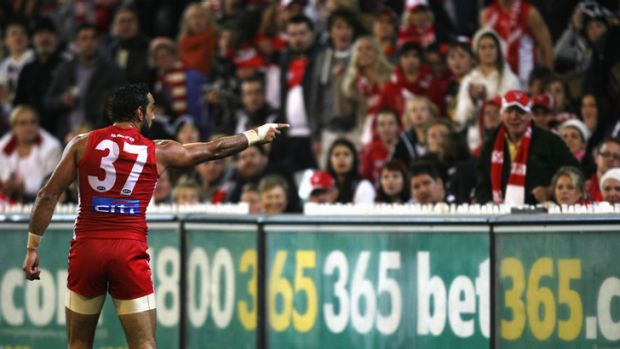 Not taking it ... Adam Goodes points the finger after being called an 'ape' by a young Collingwood supporter during the ...
