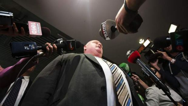Toronto Mayor Rob Ford makes a statement to the media at City Hall after his press secretary George Christopoulos and ...