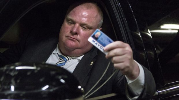 Rob Ford leaves Toronto's City Hall after fronting the media.