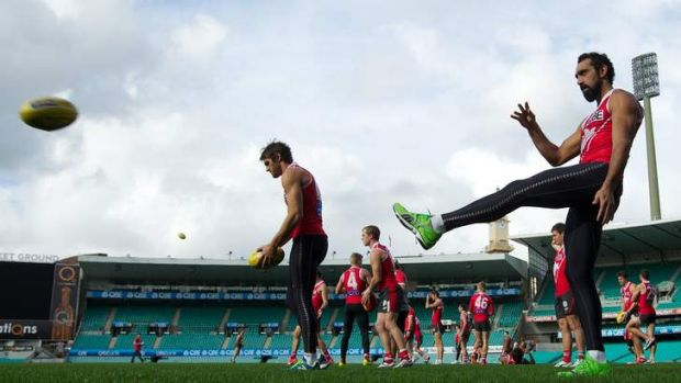 Back to the grind: Swans star Adam Goodes trains at the SCG on Tuesday after his tumultuous weekend. The Swans face  ...