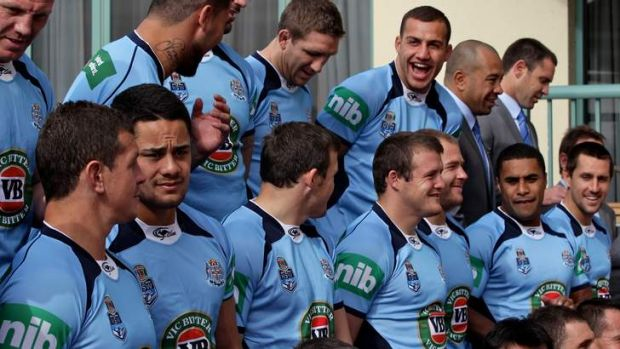 Front and centres: Josh Morris, brother Brett and the NSW squad lines up for a team photo at Coogee on Tuesday.