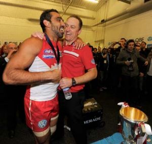 Sydney's Adam Goodes celebrates with John Longmire after the 2012 grand final.