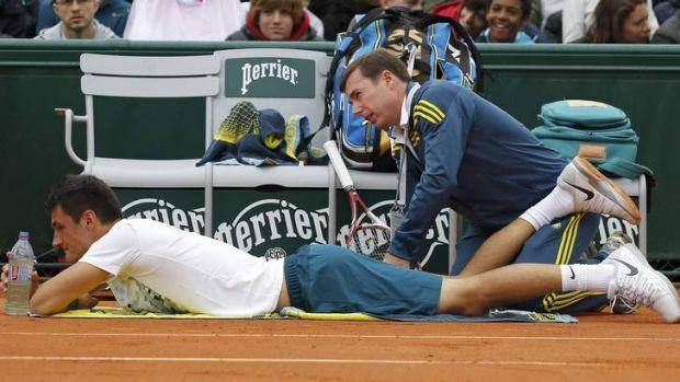 Injury: Bernard Tomic retired hurt in the opening round.
