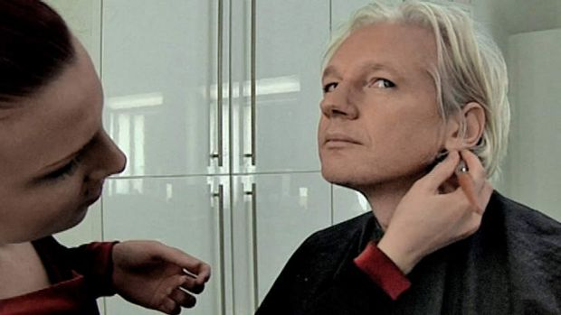 Julian Assange being prepared for a television interview. Courtesy of Universal.