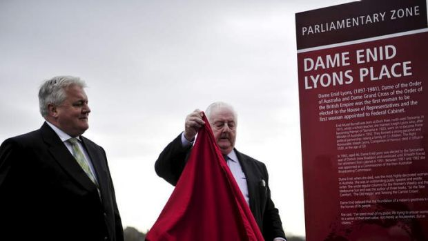 Peter Lyons and his son Peter Lyons unveil an interpretative panel honouring Dame Enid Lyons located near the National ...