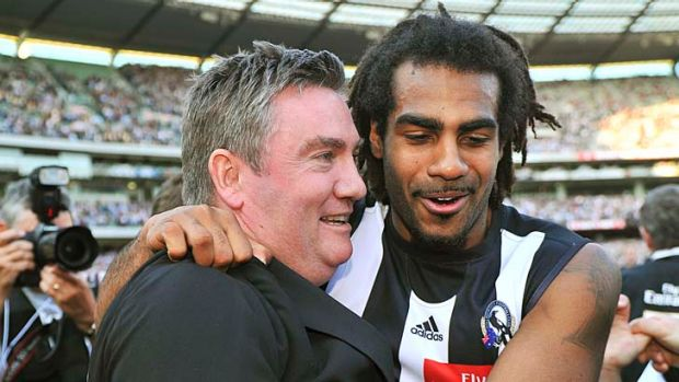 Comments by Collingwood president Eddie McGuire (left) about Adam Goodes prompted Harry O'Brien (right) to question ...