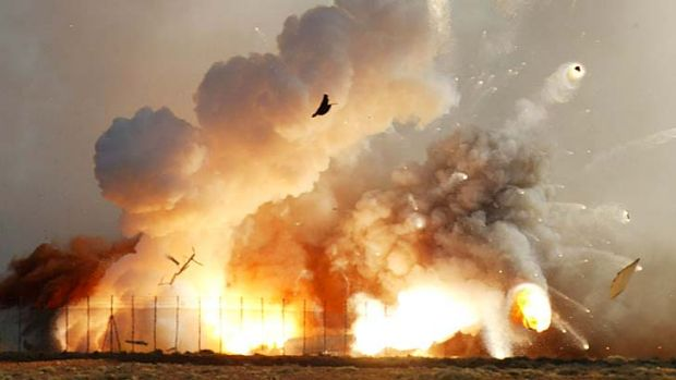 The rocket that carried the next generation supersonic model aircraft explodes after it crashed into the desert at the ...