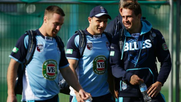No Blues: Josh Reynolds, right, speaks with Robbie Farah, centre, and James Maloney after being named in the NSW side.