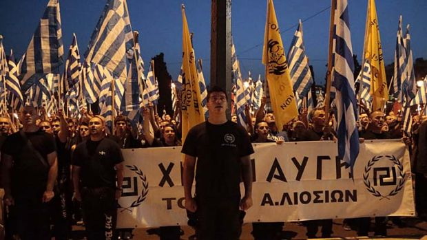 """Greece belongs to the Greeks"": Members and supporters of the extreme right party Golden Dawn march through central Athens."