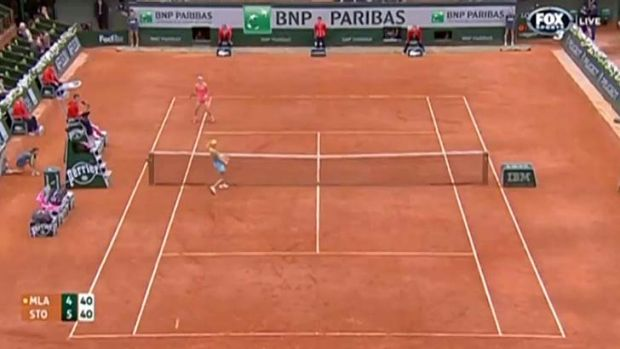 The ball flies past Samantha Stosur's opponent and hits the line.
