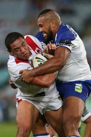 Tyson Frizell of the Dragons is tackled by Frank Pritchard of the Bulldogs.