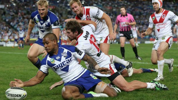 Cleaning up: Ben Barba covers back to save a try.