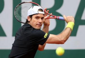 Tommy Haas of Germany plays a backhand in his Men's Singles match against Jack Sock of United States of America during ...