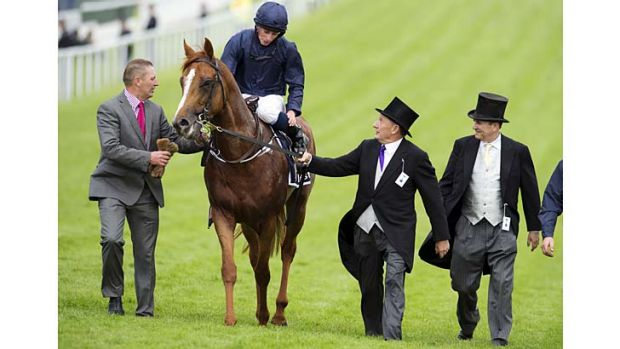 Derby delight: Ryan Moore returns Ruler Of The World to the winner's stall after the Epsom Derby.