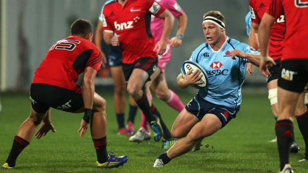 Running riot: Michael Hooper charges at Crusaders fullback Israel Dagg before giving him the slip on Friday night.
