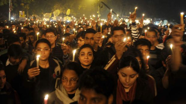 Indian protesters hold candles during a rally in New Delhi late in 2012 after the death of a gang-rape victim.