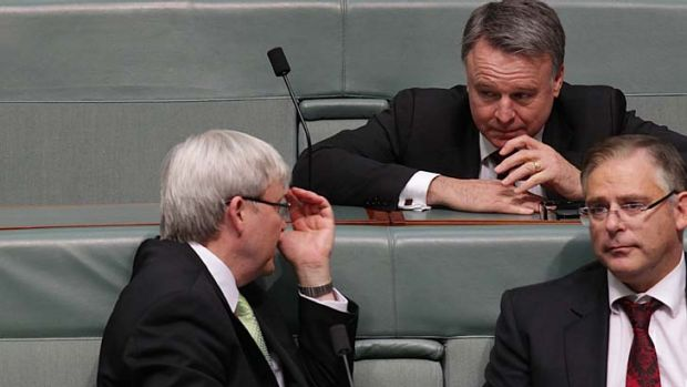 Resigned: Kevin Rudd and Joel Fitzgibbon discuss a point during Question Time.