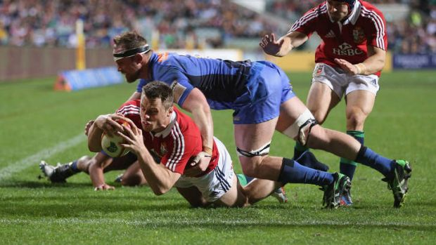 Western Farce: Tommy Bowe of the Lions dives over for a try.