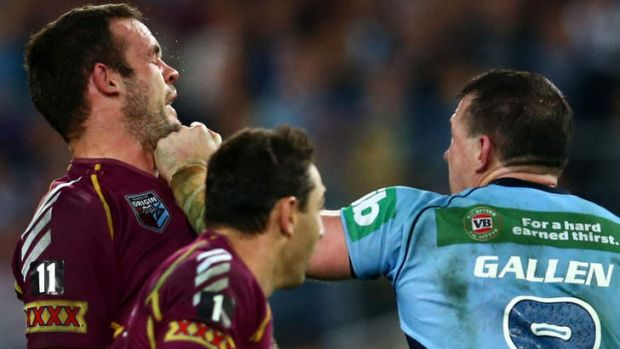 The man they love to hate: Paul Gallen punches Nate Myles.