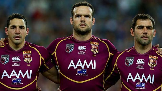 Public enemy number one: Nate Myles, centre, flanked by Billy Slater, left, and Maroons skipper Cameron Smith.
