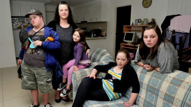 Doing it tough ... Elizabeth Friend at home with four of her five children, from left, L-R Thomas, 16, Ashleigh, 4, ...